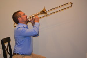 trombone with exaggerated posture