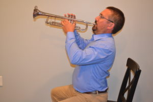 Trumpet with exaggerated posture