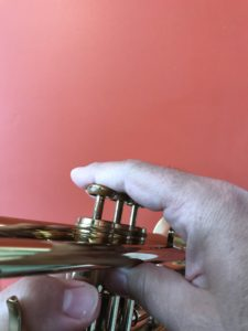 Trumpet played with flat finger